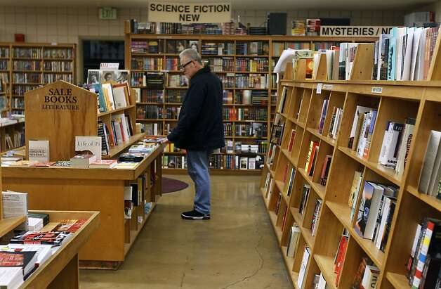 A shopper browses through the titles at Moe's Books on Telegraph Avenue in Berkeley, Calif., on Wednesday, Dec. 29, 2010. Photo: Paul Chinn, The Chronicle