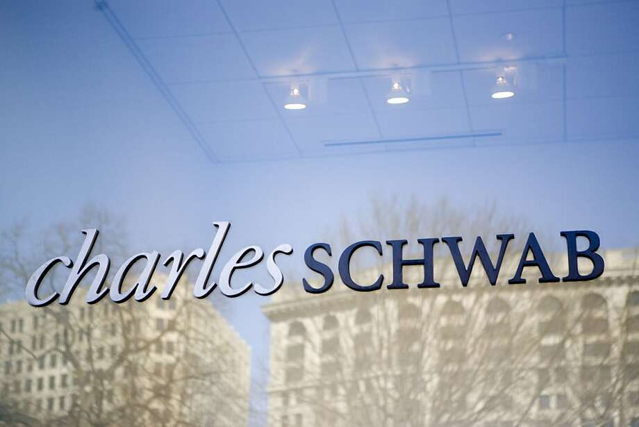 The company logo hangs in the window of a Charles Schwab branch in New York, U.S., on Tuesday, Feb. 24, 2009. Charles Schwab Corp. and other 401(k) account managers say most clients rode out the worst months of the stock market slump without changing weekly contributions or moving to more conservative money-market or bond funds. Photographer: JB Reed/Bloomberg News Photo: JB Reed, Bloomberg News