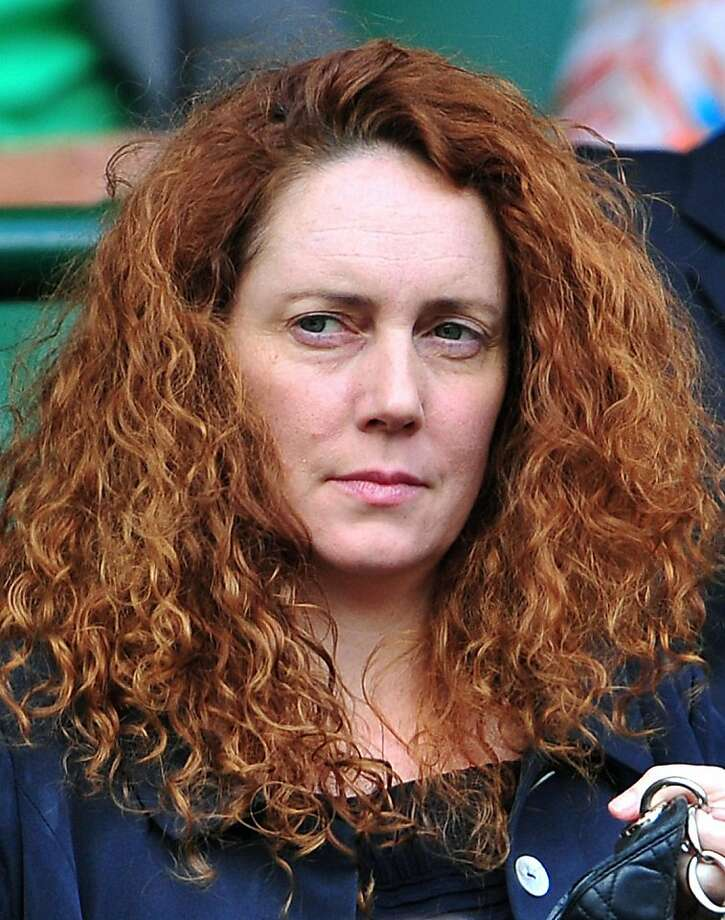 A picture taken on July 1, 2011 shows Chief Executive of News International, and former editor of Britain's News of the World newspaper, Rebekah Brooks, at the men's single semi final at the Wimbledon Tennis Championships in London.  British police on July 17, 2011 arrested Rebekah Brooks, the former head of media mogul Rupert Murdoch's British newspaper wing, over the phone hacking scandal, British media reported. Scotland Yard said in a statement that a 43-year-old woman had been arrested over allegations of phone hacking and corruption. They would not confirm it was Brooks, 43, and there was no immediate comment from News International. Photo: Leon Neal, AFP/Getty Images