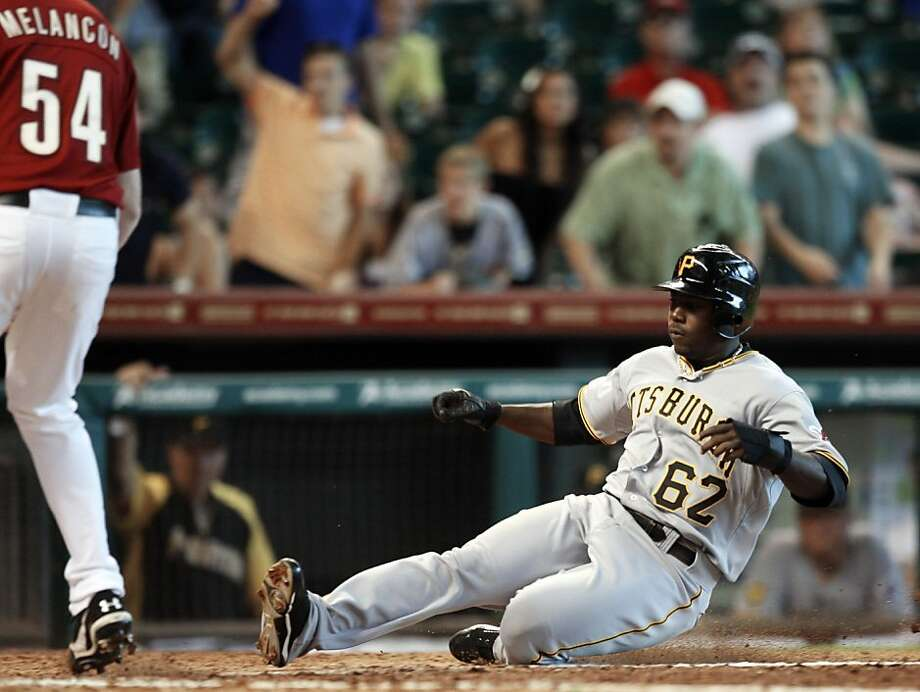 HOUSTON - JULY 17: Josh Harrison #62 of the Pittsburgh Pirates scores on a passed ball in the eleventh inning against the Houston Astros at Minute Maid Park on July 17, 2011 in Houston, Texas. Photo: Bob Levey, Getty Images