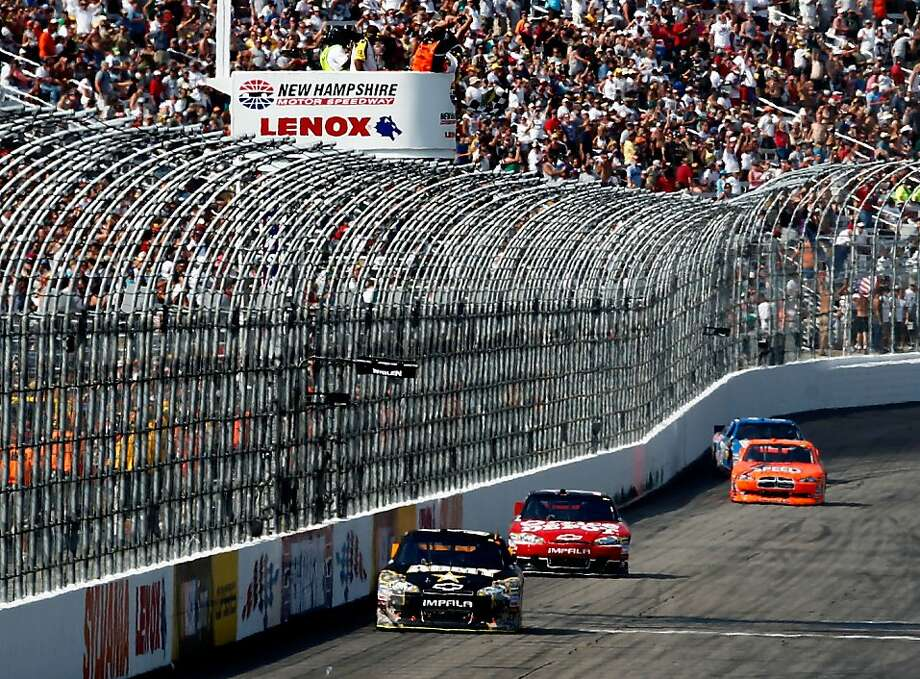 LOUDON, NH - JULY 17:  Ryan Newman, driver of the #39 U.S. Army Chevrolet, takes the checkered flag ahead of Tony Stewart, driver of the #14 Office Depot/Mobil 1 Chevrolet, to win the NASCAR Sprint Cup Series LENOX Industrial Tools 301 at New Hampshire Motor Speedway on July 17, 2011 in Loudon, New Hampshire.  (Photo by Jeff Zelevansky/Getty Images for NASCAR) Photo: Jeff Zelevansky, Getty Images For NASCAR