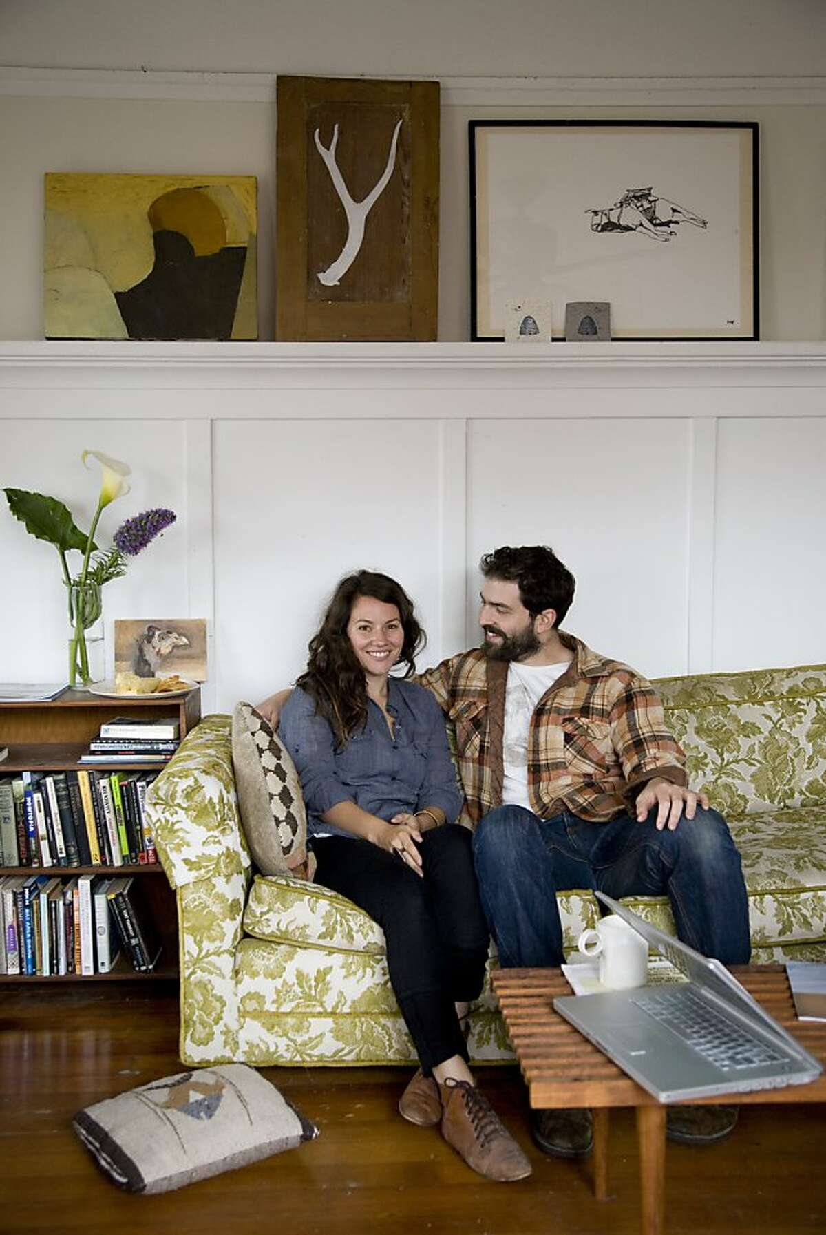 Artist and ceramicist Jessica Niello and chef Sam White sit in the living room of their homespun West Oakland retreat.