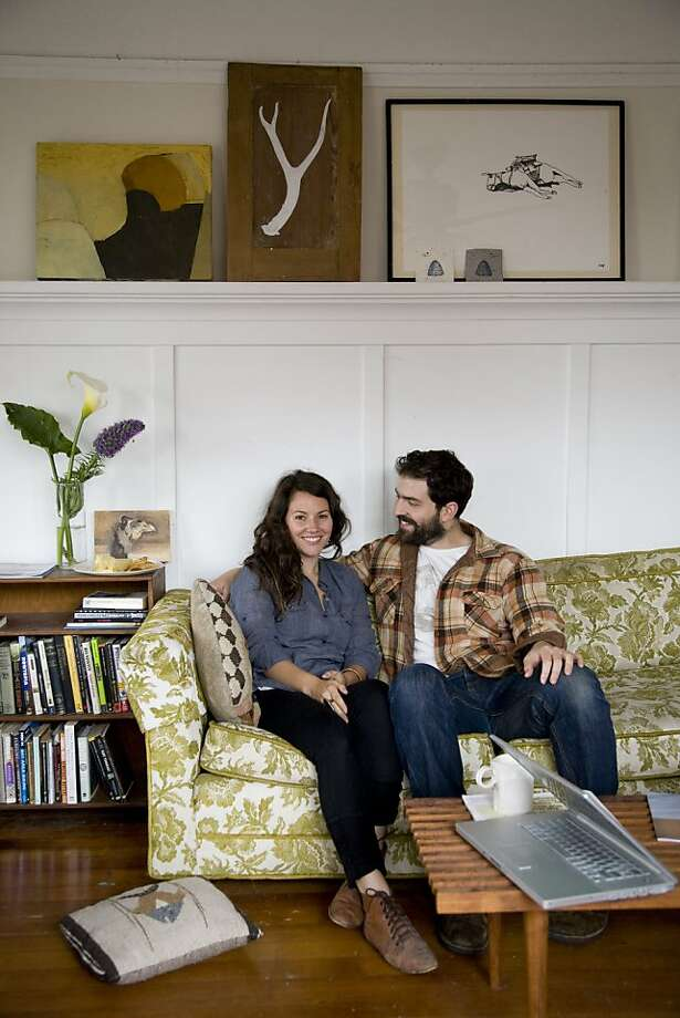 Artist and ceramicist Jessica Niello and chef Sam White sit in the living room of their homespun West Oakland retreat. Photo: Kelly Ishikawa, Styling By Rod Hipskind