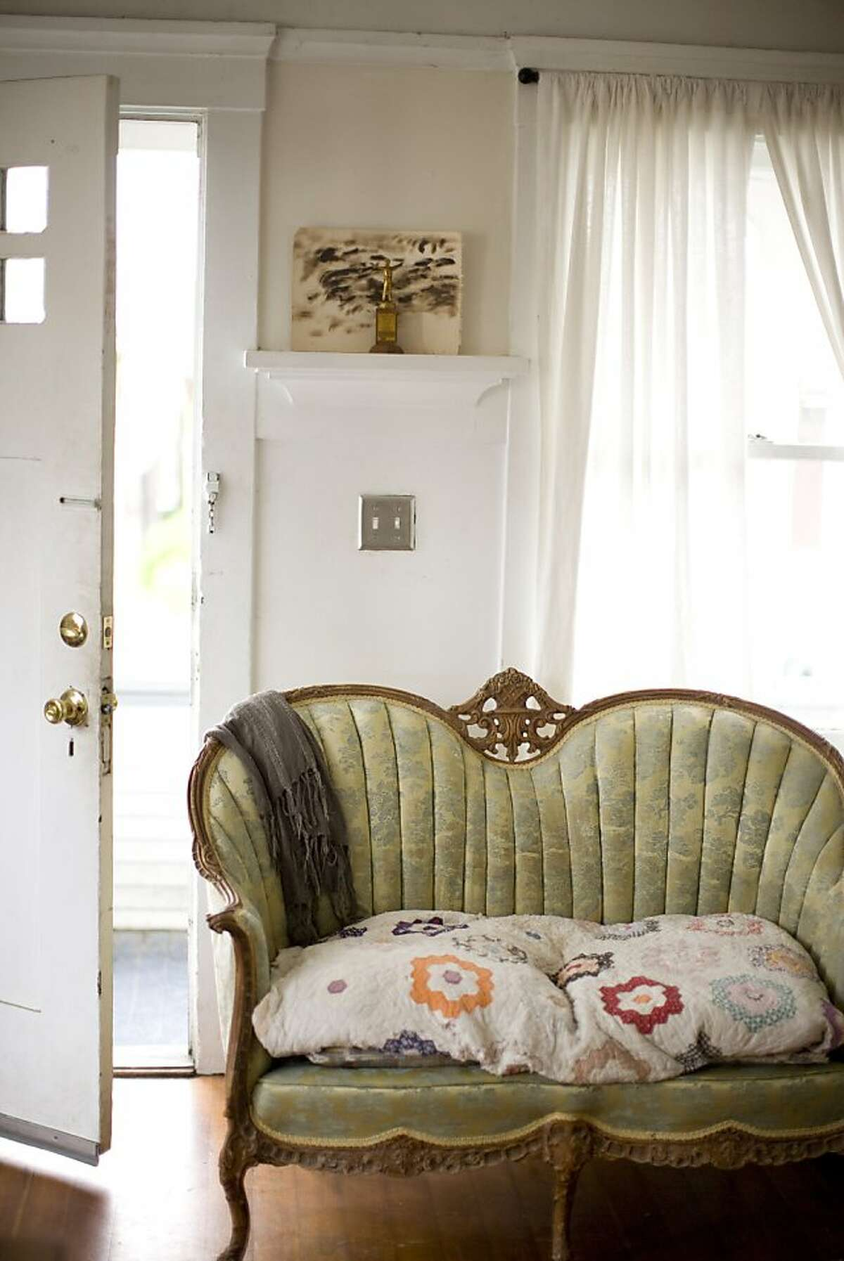 A Victorian love seat is one of the stars of the living room.