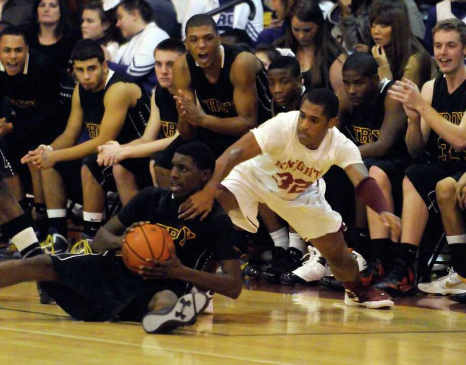 Troy's Isiah Dobere grabs a loose ball from Gibbons James Vice during their high school boys basketball game in Schenectady, NY Tuesday, Dec.6, 2011.( Michael P. Farrell/Times Union) Photo: Michael P. Farrell