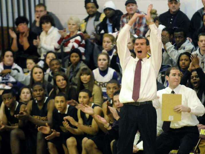 Troy's head coach Richard Hurley calls a time out during their high school boys basketball game agai