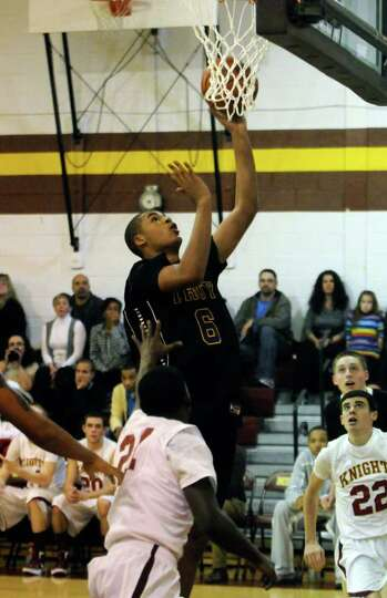 Troy's Javion Ogunyemi goes in for a basket during their high school boys basketball game against Bi