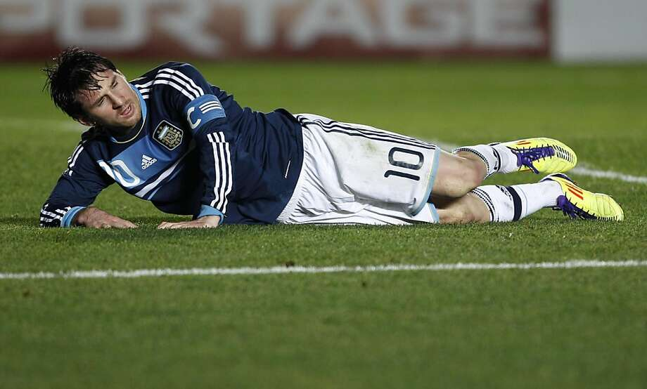 Argentina's Lionel Messi lies on the ground during a Copa America quarterfinal soccer match against Uruguay in Santa Fe, Argentina, Saturday, July 16, 2011. Photo: Natacha Pisarenko, AP