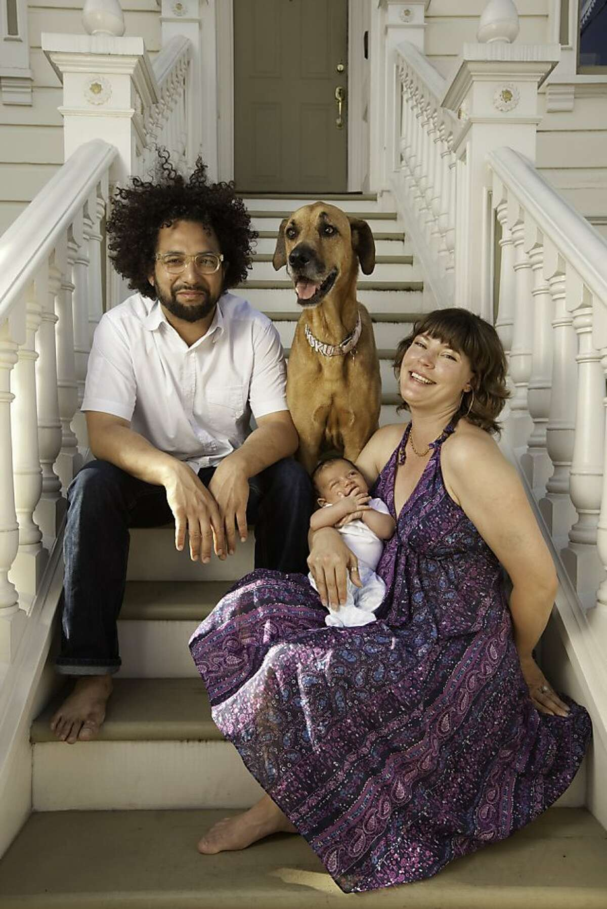 Ravi Kapur, chef of Prospect restaurant, and his wife, April, with their 6 week-old son, Makoa, and dog, Hoku in San Francisco, California, on Monday, June 20, 2011.