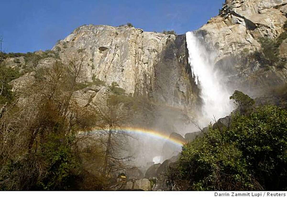 A rainbow forms at the foot of Bridalveil Fall in Yosemite Valley on April 19, 2008.