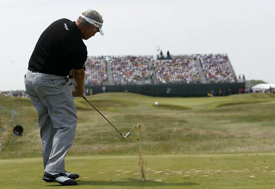 Northern Ireland's Darren Clarke plays a shot on the 16th fairway during the second day of the  British Open Golf Championship at Royal St George's golf course Sandwich, England, Friday, July 15, 2011. Photo: Peter Morrison, AP