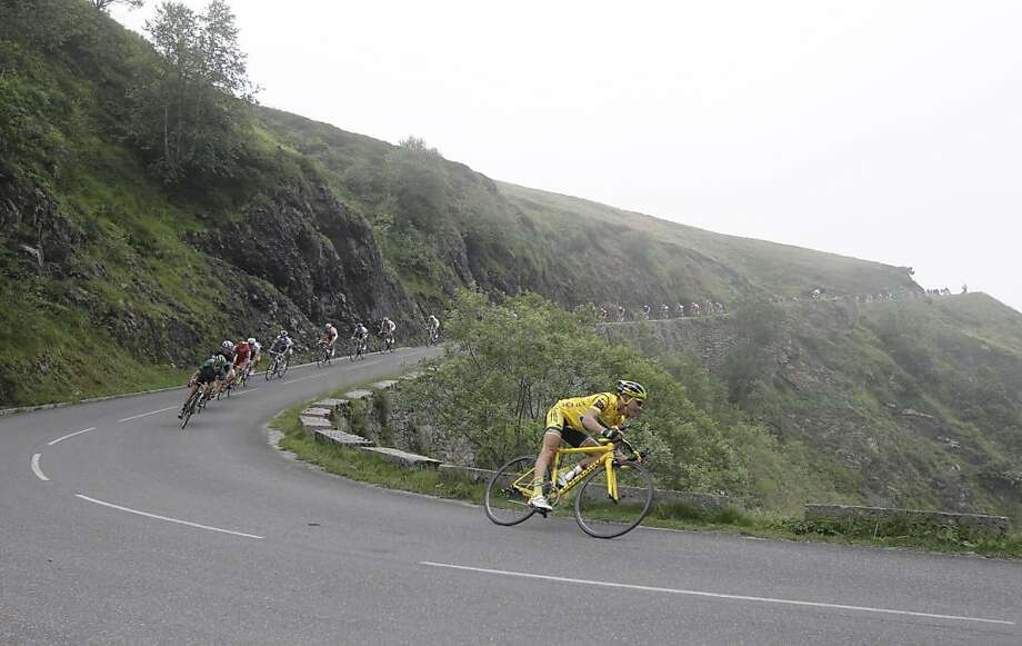 Thomas Voeckler of France, wearing the overall leader's yellow jersey, speeds down a foggy Aubisque pass during the 13th stage of the Tour de France cycling race over 152.2 kilometers (94.6 miles) starting in Pau and finishing in Lourdes, Pyrenees region,France, Friday July 15, 2011. Photo: Laurent Cipriani, AP