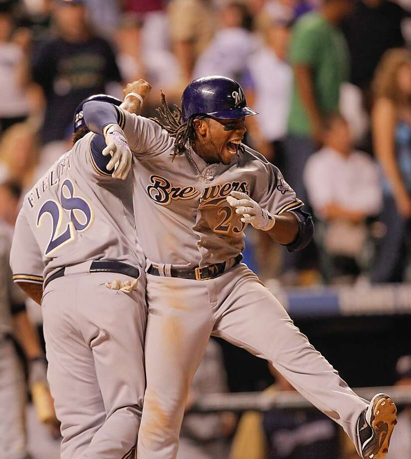 DENVER, CO - JULY 16: Rickie Weeks #23 of the Milwaukee Brewers celebrates his two run go ahead home run with Prince Fielder #28 in the ninth inning against Huston Street #16 of the Colorado Rockies at Coors Field on July 16, 2011 in Denver, Colorado. Photo: Justin Edmonds, Getty Images