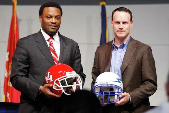 Houston coache Kevin Sumlin, left, and Air Force coach Troy Calhoun  were on hand for the Armed Forces Bowl NCAA college football game reception at sponsor Bell Hellicopter at Alliance Airport in Fort Worth, Texas on Thursday Dec. 11, 2008. The game is Dec. 31 in Fort Worth. (AP Photo/Fort Worth Star-Telegram, Ron T. Ennis) ** MAGS OUT. NO SALES. ONLINE OUT **