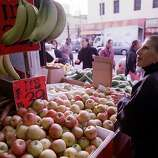 Chef and food scholar Barbara Tropp goes shopping in Chinatown for an upcoming dinner party at her home in 1999.