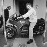 Jeremiah Tower outside his Stars restaurant with the new love of his life, a new BMW motorcycle he bought after taking full control of the restaurant.