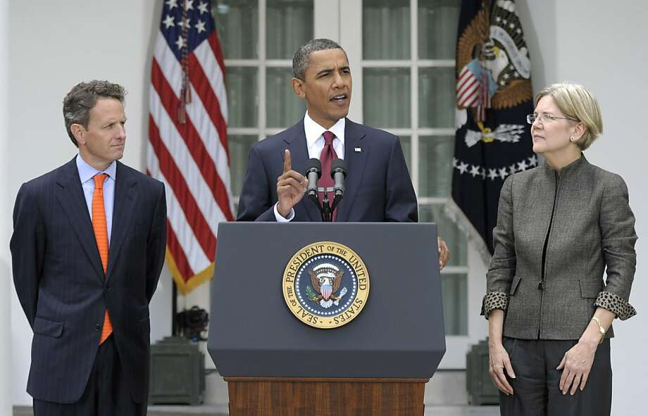 President Barack Obama, accompanied by Elizabeth Warren, right, and Treasury Secretary Timothy Geithner, left, announces that Warren will head the Consumer Financial Protection Bureau, Friday, Sept. 17, 2010, during an event in the Rose Garden of the White House in Washington. Photo: Susan Walsh, AP