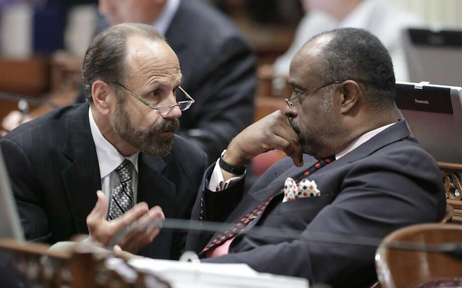 Assemblyman Jerry Hill, D-San Mateo, left, talks with state Sen. Rod Wright, D-Inglewood during the Senate session at the Capitol in Sacramento, Calif., Thursday, July 14, 2011.  Hill's measure designed to make California more relevant in presidential politics by giving the state's electoral votes to the candidate who wins the national popular vote was approved by the Senate and sent to the governor. Photo: Rich Pedroncelli, AP