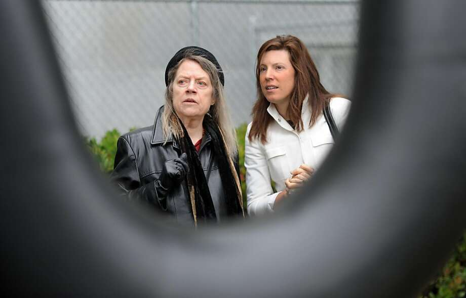 Ann Voulkos (wife of the late Peter Voulkos) and Jennifer Gately (Executive Director of the San Francisco Art Dealer Association) gather for a re-dedication ceremony of a 1971 statue created by Peter Voulkos on July 15, 2011. The statue sits outside of the Hall of Justice in San Francisco. The Arts Commission has recently restored it using public donations. Photo: Susana Bates, Special To The Chronicle