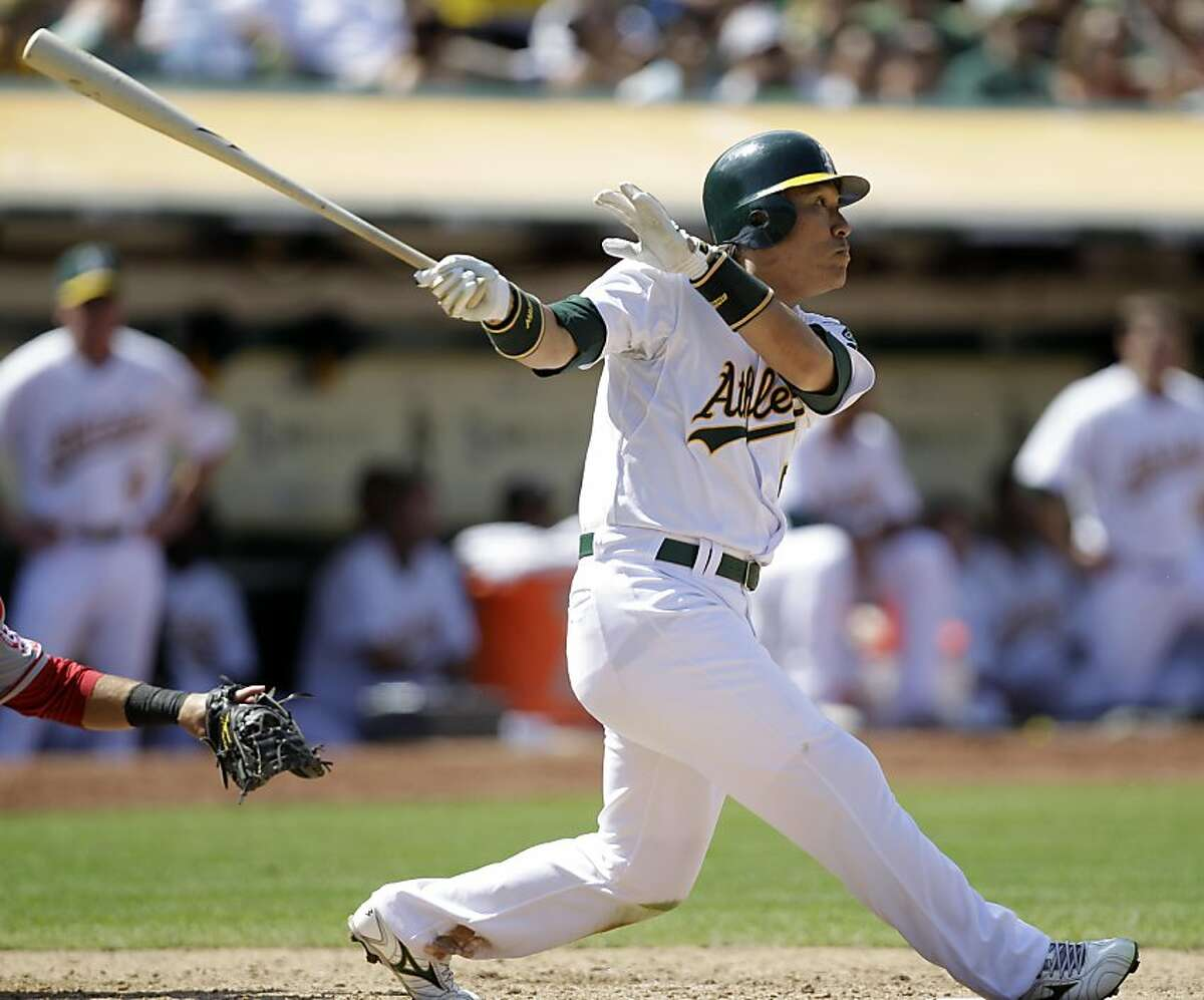 Oakland Athletics' Hideki Matsui, of Japan, swings for a double against the Los Angeles Angels during the eighth inning of the first baseball game of a double header, Saturday, July 16, 2011, in Oakland, Calif.
