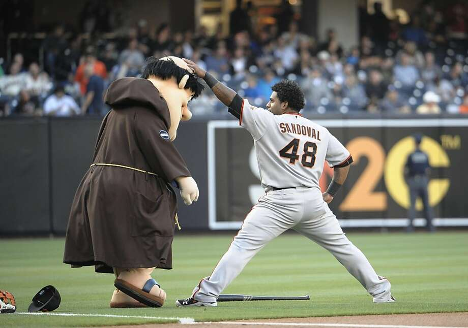 SAN DIEGO, CA - JULY 14: Pablo Sandoval #48 of the San Francisco Giants rubs the head of San Diego Padres mascot The Friar before a baseball game at Petco Park on July 14, 2011 in San Diego, California. Photo: Denis Poroy, Getty Images