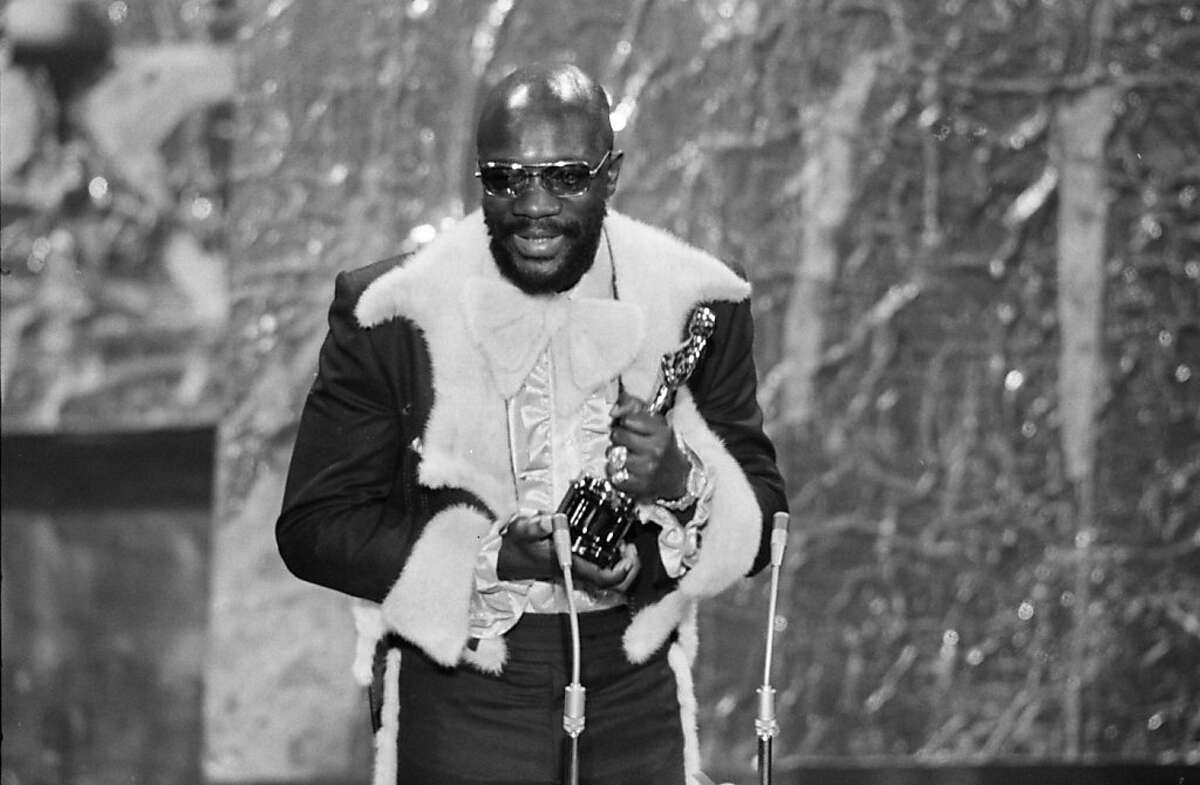 """In this April 11, 1972 picture, Isaac Hayes holds his Oscar for best song """"Theme From Shaft"""" from the movie """"Shaft"""" during the Academy Awards ceremonies in the Dorothy Chandler Pavilion."""