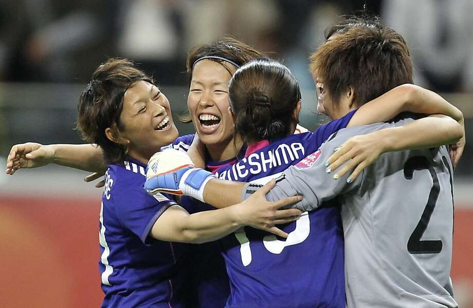 Japan players celebrate winning 3-1 the semifinal match between Japan and Sweden at the Women's Soccer World Cup in Frankfurt, Germany, Wednesday, July 13, 2011. Photo: Michael Probst, AP