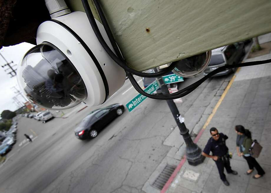 One of the installed cameras (left) can record quality facial features a half block away. Four months after the murder of Jesus Campos, Oakland, Calif. merchants are installing cameras along International Blvd. to help with investigations. Seventeen cameras are being installed between 42nd Avenue and Fruitvale Street. Photo: Brant Ward, The Chronicle