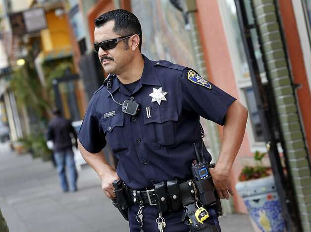 Officer Jorge Pereda, who regularly patrols International Blvd. is pleased with the new cameras and is hoping for more. Three months after the murder of Jesus Campos, Oakland, Calif. merchants are installing cameras along International Blvd. to help with investigations. Seventeen cameras are being installed between 42nd Avenue and Fruitvale Street. Photo: Brant Ward, The Chronicle
