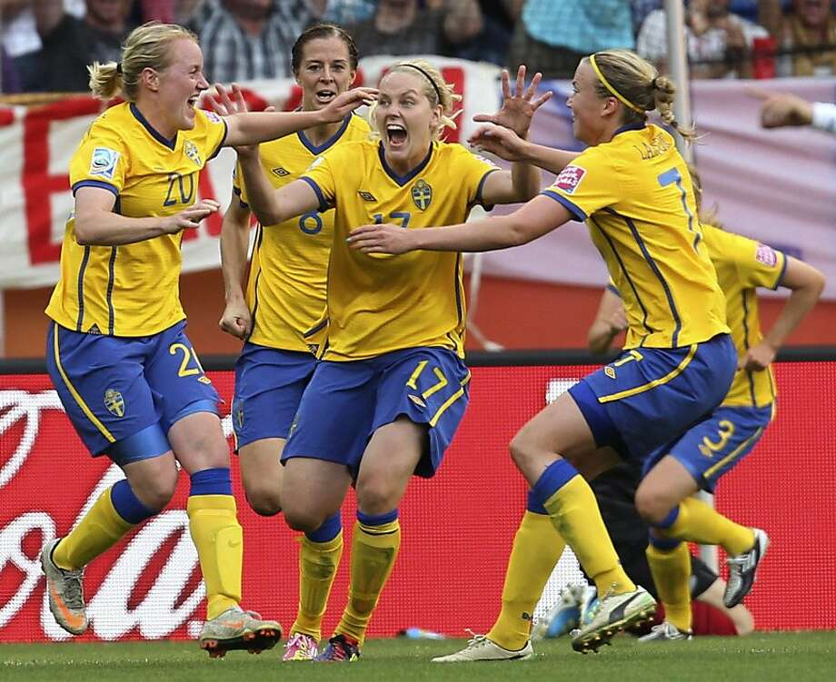 Sweden's Marie Hammarstrom, left, is celebrated by teammates after scoring her side's second goal during the match for third place between France and Sweden at the WomenÍs Soccer World Cup in Sinsheim, Germany, Saturday, July 16, 2011. Photo: Michael Probst, AP