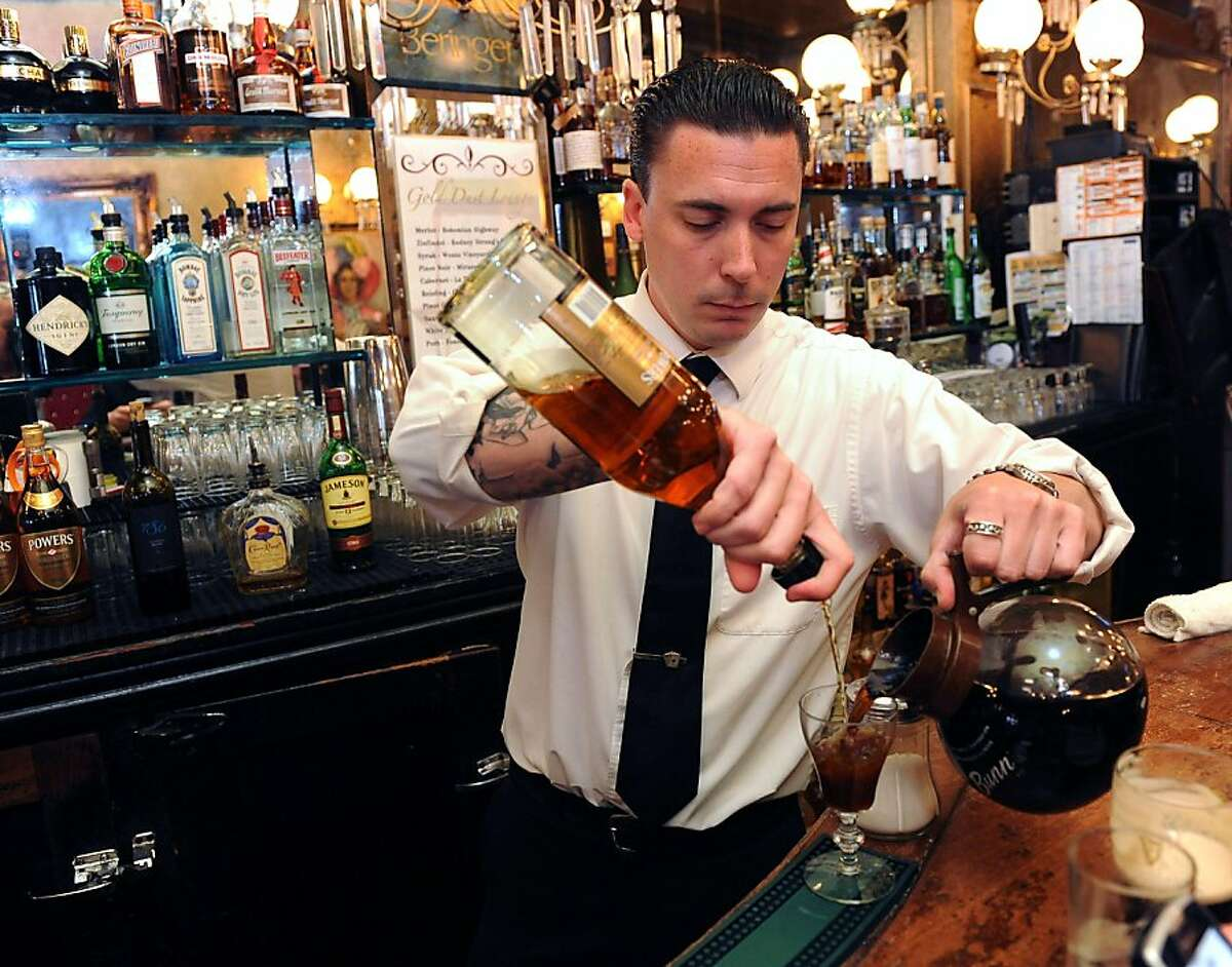 Casey Lippi makes Irish coffees at the Gold Dust Lounge on July 15, 2011. The original Irish coffee glasses were discontinued and the Gold Dust Lounge has been using other glasses. With the news that they will now be able to obtain the original glasses they have started using the original glasses that they had in stock.