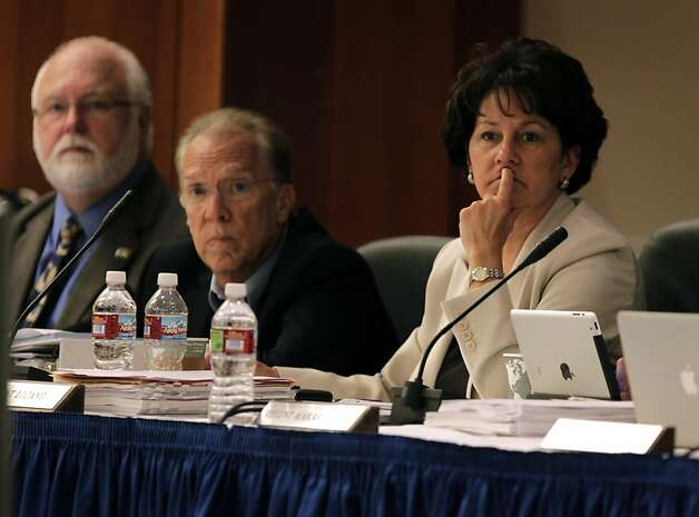 UC regent Monica Lozano, right, listens to public comments along with regents William De La Pena, left, and Norman Pattiz, center, before the board votes whether or not to raise tuition by 9.6 percent in San Francisco, Calif. on Thursday, July 14, 2011. Lozano, also on the board of directors for the Disney Corporation, was the focus of attention by students protesting the increased tuition plan. Photo: Paul Chinn, The Chronicle