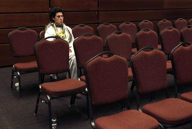 Sam Lewis sits alone in the auditorium after UC regents voted 14-4 to raise tuition by 9.6 percent in San Francisco, Calif. on Thursday, July 14, 2011. Lewis was among a group of Southern California students that do not attend UC schools but showed up to express their displeasure. Photo: Paul Chinn, The Chronicle