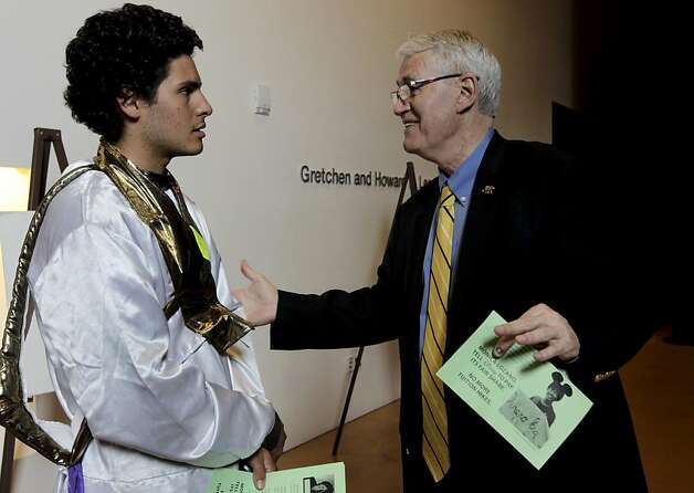 Wearing an Aladdin costume, protester Sam Lewis speaks with UC Berkeley Chancellor Robert Birgeneau in the hallway outside the auditorium before UC regents voted 14-4 to raise tuition by 9.6 percent in San Francisco, Calif. on Thursday, July 14, 2011. Photo: Paul Chinn, The Chronicle
