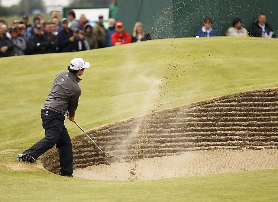 Northern Ireland's Rory McIlroy plays a shot out of the bunker on the 15th hole during the first day of the British Open Golf Championship at Royal St George's golf course Sandwich, England, Thursday, July 14, 2011. Photo: Peter Morrison, AP