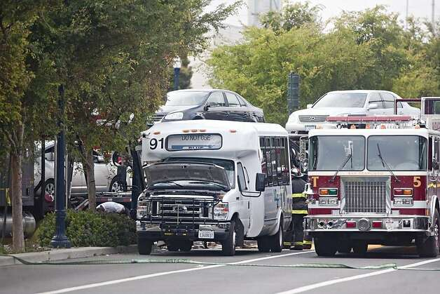 The UCSF shuttle bus involved in a fatal accident July 14, 2011, with a big rig carrying cars in San Francisco's Hayes Valley. Photo: Jim Herd, Special To The Chronicle