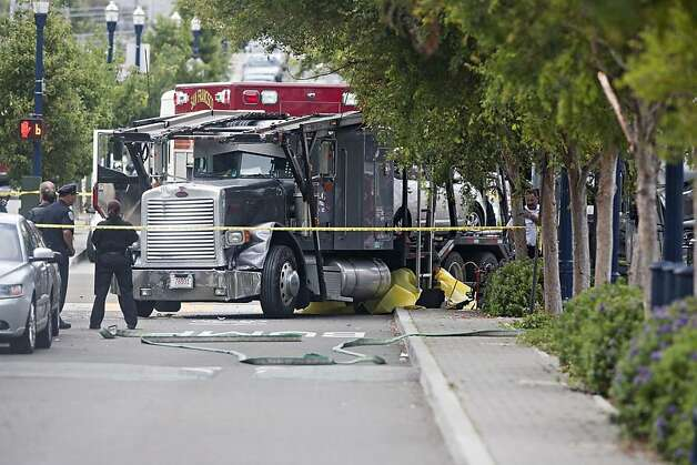 The big rig involved in a fatal accident July 14, 2011, with a UCSF shuttle bus in San Francisco's Hayes Valley. The body of a shuttle bus passenger was pinned under the truck. Photo: Jim Herd, Special To The Chronicle