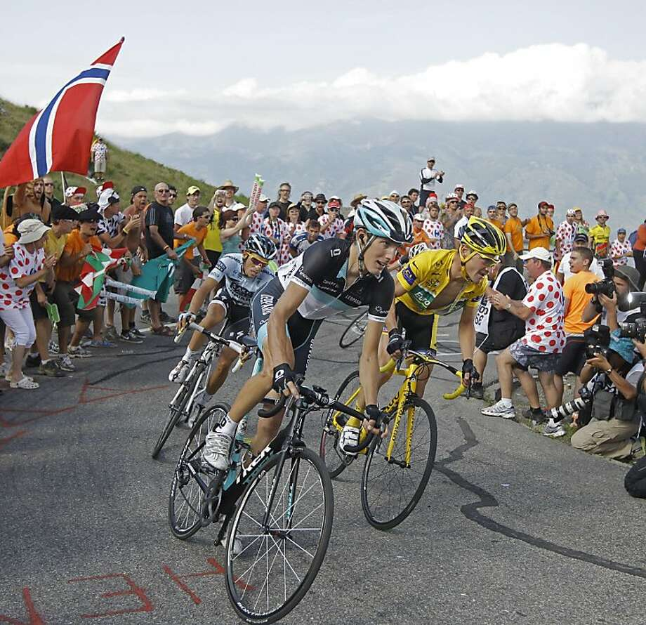 Three-time Tour de France winner Alberto Contador of Spain, Andy Schleck of Luxembourg, and Thomas Voeckler of France, wearing the overall leader's yellow jersey, from left to right, climb towards Plateau de Beille during the 14th stage of the Tour de France cycling race over 168.5 kilometers (104.7 miles) starting in Saint Gaudens and finishing in Plateau de Beille, Pyrenees region, France, Saturday July 16, 2011. Photo: Laurent Cipriani, AP