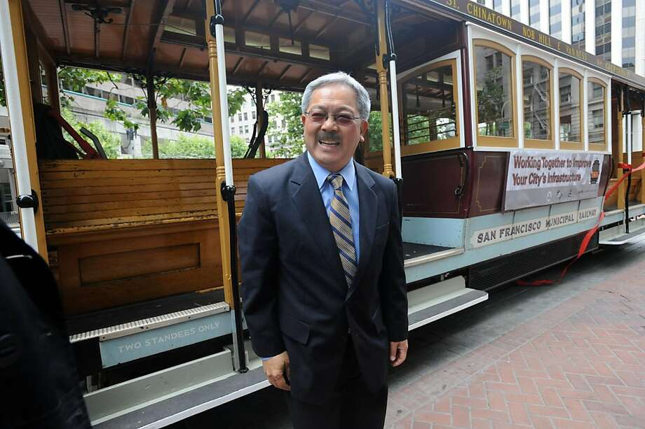 Mayor Ed Lee is seen in front of  a California St. cable car in San Francisco on June 27, 2011. The city held a ribbon cutting ceremony to welcome back the line after being closed due to repairs since December. Photo: Susana Bates, Special To The Chronicle