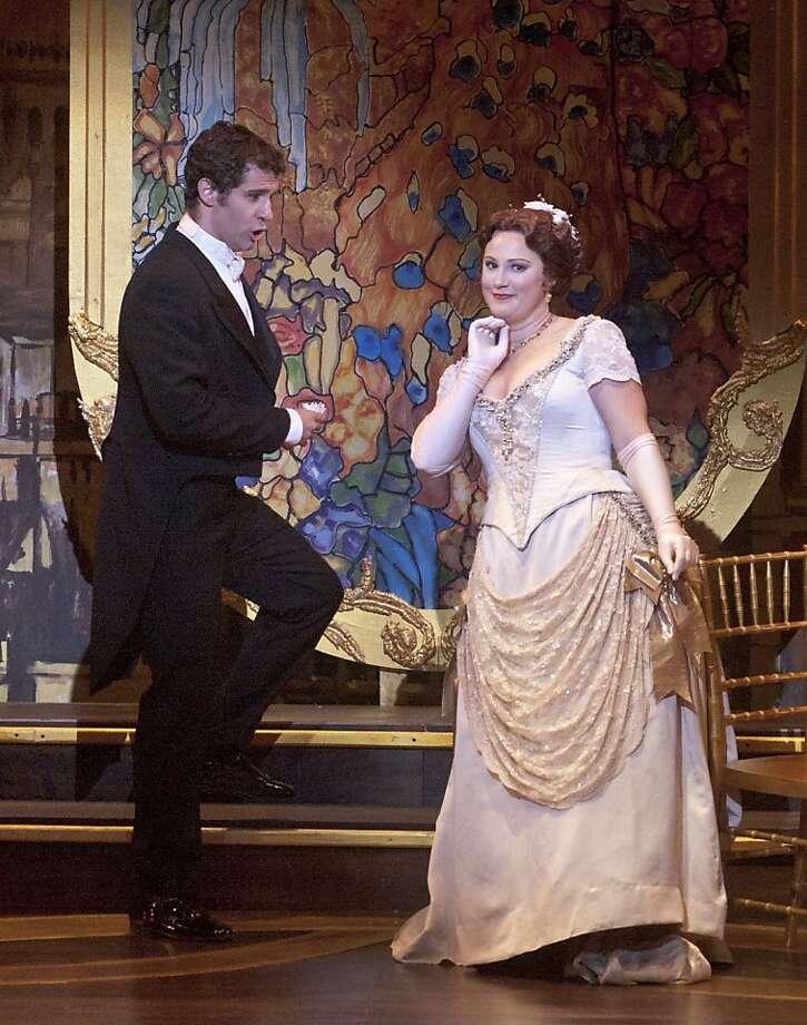 """Andrew Whitfield (l.) as Alfredo and Rebecca Davis as Violetta in Verdi's """"La Traviata"""" at Festival Opera Photo: Robert Shomler"""