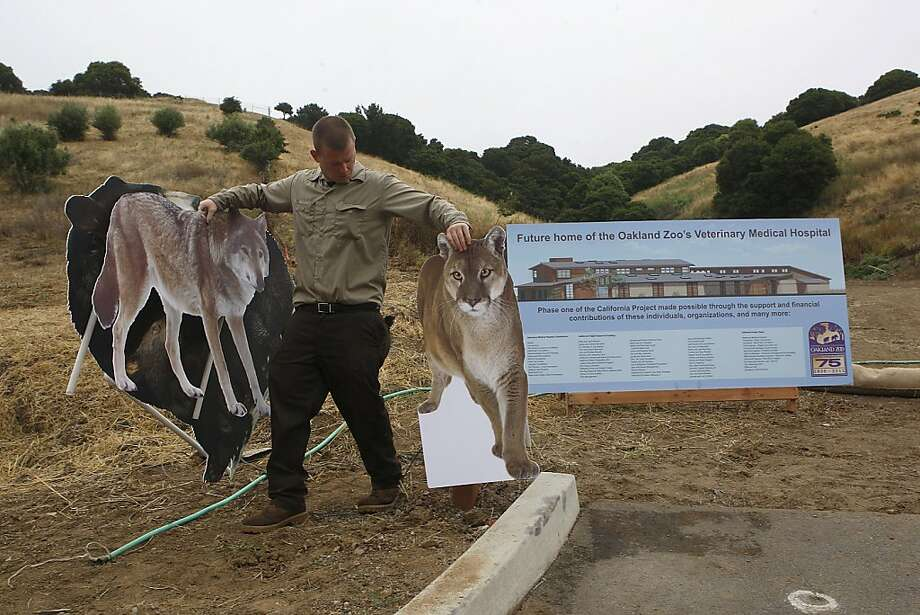 Oakland Zoo breaks ground on a new veterinary hospital in Oakland, Calif., on Wednesday, July 13, 2011.  The hospital will be located just beyond the huge sign and before the hills.  It will be used to train student veterinarians as well as to treat the zoo animals. Photo: Liz Hafalia, The Chronicle