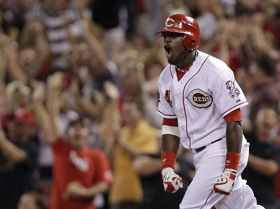 Cincinnati Reds' Brandon Phillips rounds the bases after hitting a two-run walk off home run off St. Louis Cardinals relief pitcher Fernando Salas in the ninth inning of a baseball game, Friday, July 15, 2011 in Cincinnati. Cincinnati won 6-5. Photo: Al Behrman, AP