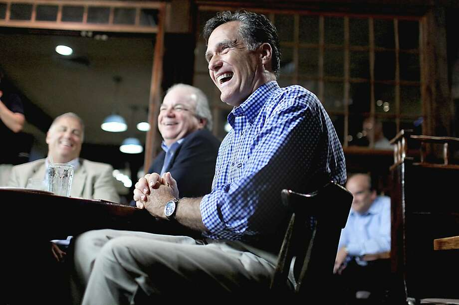 FILE - In this July 5, 2011, file photo, Republican presidential candidate, former Massachusetts Gov. Mitt Romney, meets with local business owners during a town hall meeting in Hampton, N.H. A month ago, the Republicans who would be president gathered for a debate in New Hampshire and had nothing but nice things to say about one another. With Romney leading polls everywhere and Rep. Michele Bachmann suddenly a threat in leadoff caucus state Iowa, Republicans who'd been working to introduce themselves tothe nation now are feeling the need to take their GOP competitors down a notch. Photo: Cheryl Senter, Associated Press