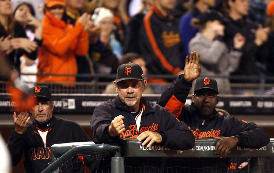 San Francisco Giants Manager Bruce Bochy center motions to Bill Hall prior to Hall batting against the San Diego Padres Wednesday, July 7, 2011, in San Francisco.