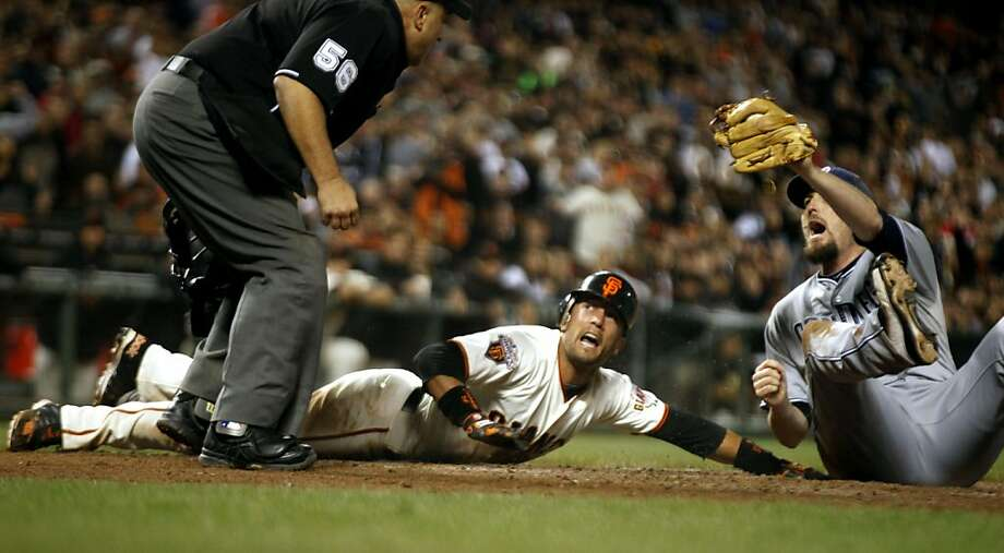 San Francisco Giants Andres Torres is called out at home plate by Eric Cooper on a fielderês choice from Padres catcher Nick Hundley to pitcher Chad Qualls in the 7th inning. Tuesday, July 5, 2011, in San Francisco. Photo: Lance Iversen, The Chronicle
