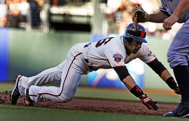 San Francisco Giants Andres Torres dives safley into first base on a pick off attempt in the forst inning by San Diego Padres starting pitcher Tim Stauffer in the first inning. Tuesday, July 5, 2011, in San Francisco. Photo: Lance Iversen, The Chronicle