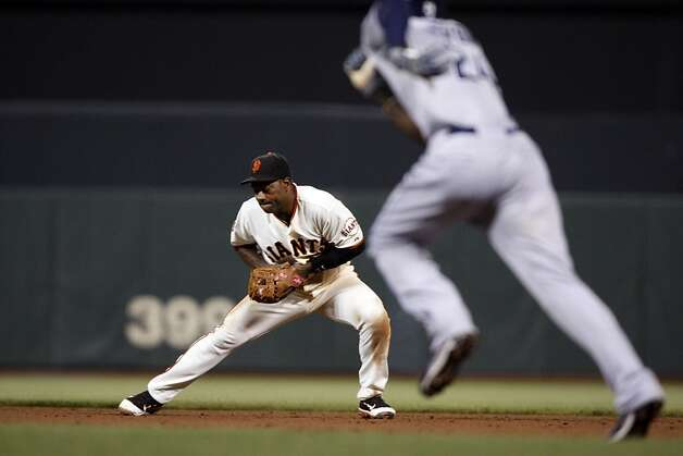 San Francisco Giants Miguel Tejada playing second base for the first time as a Giant turns a double play, fields Padres, Anthony Rizzo's ground ball, and throwing out Cameron Maybin at second in the 9th inning. Tuesday, July 5, 2011, in San Francisco. Photo: Lance Iversen, The Chronicle