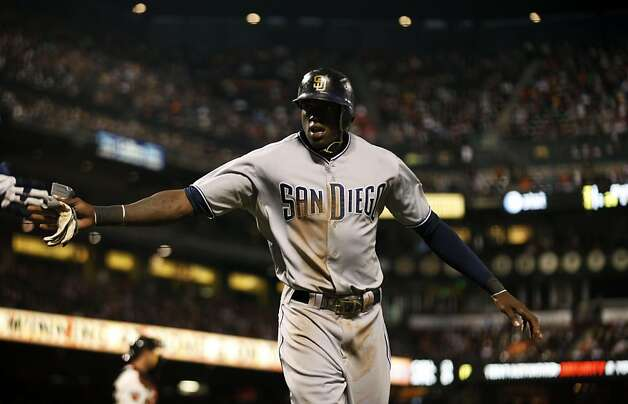 San Diego Padres Cameron Maybin is greeted at the dugout after scoring during their game with the San Francisco Giants Tuesday, July 5, 2011, in San Francisco. The Padres beat the Giants 5-3. Photo: Lance Iversen, The Chronicle