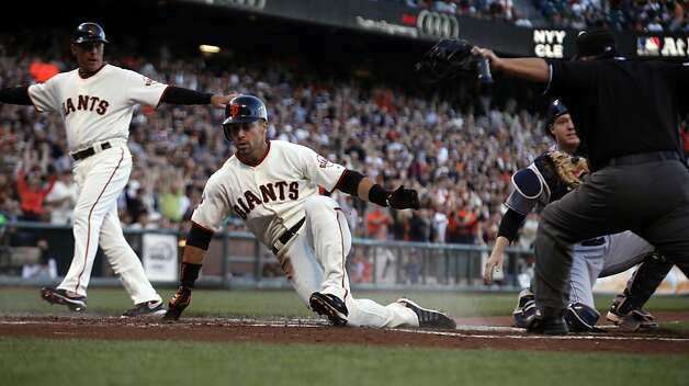 San Francisco Giants Andres Torres slides safley into home off a single by Brandon Crawford. San Diego Padres Orlando Hudson was given an error on the play during the first inning Tuesday, July 5, 2011, in San Francisco. Photo: Lance Iversen, The Chronicle