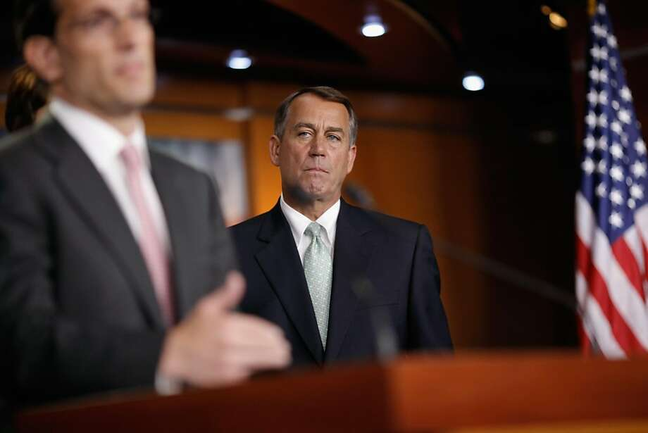 WASHINGTON, DC - JULY 15:  Speaker of the House John Boehner (R-OH) (R) listens to House Majority Leader Eric Cantor (R-VA) during a news conference after a House GOP caucus meeting at the U.S. Capitol July 15, 2011 in Washington, DC. As an August 2 deadline looms, Boehner, Cantor and House Republicans talked the latest developments in the ongoing federal budget and debit ceiling negotiations with the White House and Congressional Democrats. Photo: Chip Somodevilla, Getty Images